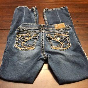 Silver jeans light distress.  W27/L32